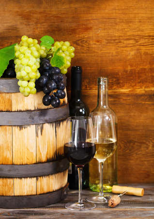 intoxicant:  Still life with red and white wine, bottles and barrel