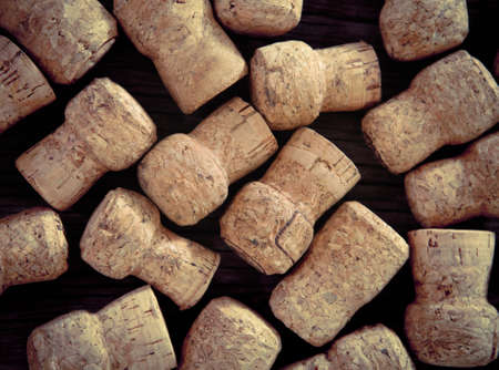 Dated wine bottle corks on the wooden background. Close up Stock Photo - 18011422