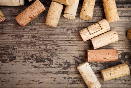brown cork: Dated wine bottle corks on the wooden background. Close up