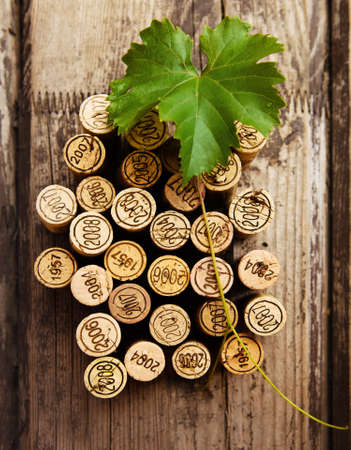 Dated wine bottle corks on the wooden background. Close up photo
