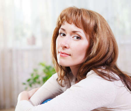 redhaired: Close up portrait of happy young woman indoor Stock Photo