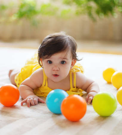 babies with toys: Close up portrait of the eight mounth old baby indoor Stock Photo
