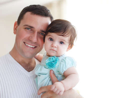 Happy young father with little daughter indoors photo