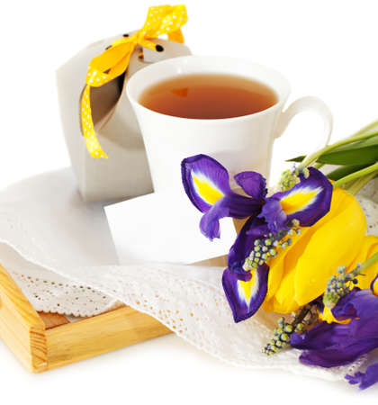 Tea with flowers and gift box for mom in Mothers Day photo