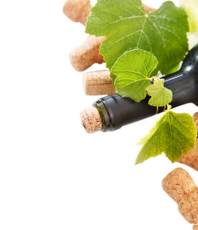 dated: Dated wine bottle corks and bottle on the white background with copy space Stock Photo