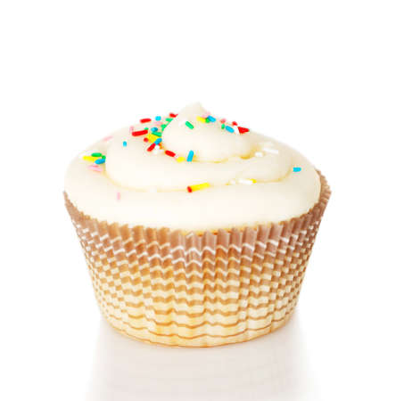 dragees: One white cupcake isolated on the white background