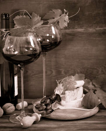 intoxicant: Still life with glasses of red wine, bottle and chesse