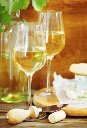 intoxicant: Still life with glasses of white wine, bottle and chesse Stock Photo