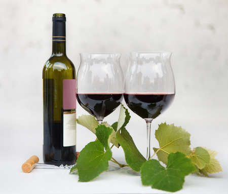 intoxicant: Still life with glasses of red wine, bottle and leaves of grape