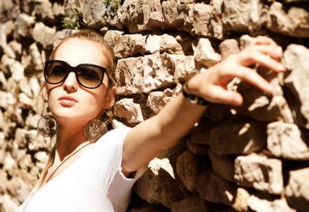 Beautiful blond woman outdoor on the street of the old town photo