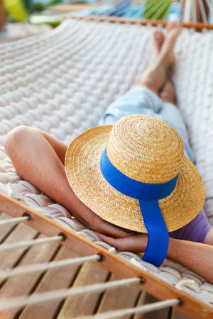 nap: Lazy time. Man in hat in a hammock on a summer day Stock Photo