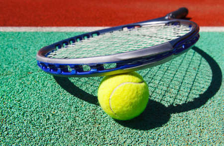 Close up of tennis racquet and ball on the clay tennis court Stock Photo - 20523692