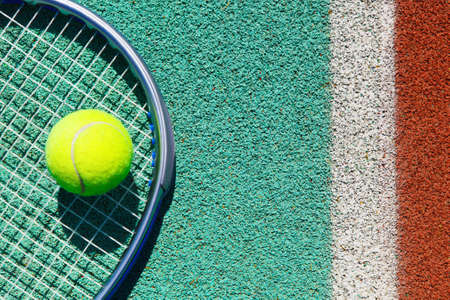 tennis clay: Close up of tennis racquet and ball on the clay tennis court