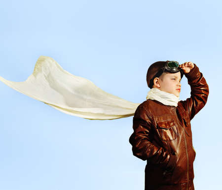 airman: Little boy dreaming of becoming a pilot in retro style uniform Stock Photo