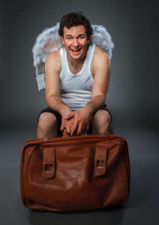 Mr. Angel with brown bag. Crazy character portrait photo