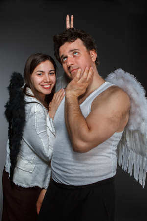 Mr. Angel and Mrs. Angel. Crazy character portrait photo