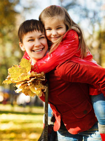 Happy young mother with daughter on autumn picnic photo