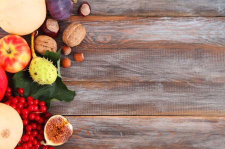 Autumn still life over wooden background photo