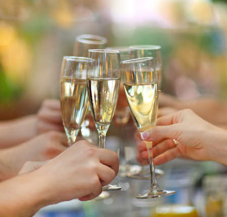 champagne party: Celebration. People holding glasses of champagne making a toast