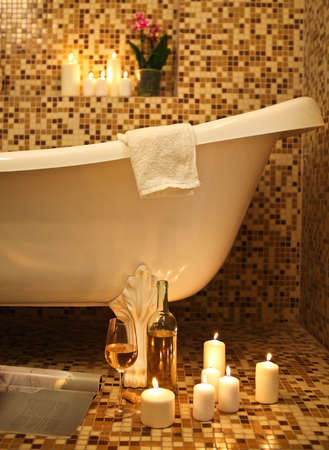 whine: Home bathroom interior with bubble bath, candles, magazine and white whine. Relax concept Stock Photo