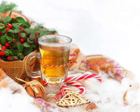 christmas tea: Christmas still life with a Christmas decorations and hot tea nestling in fresh snow Stock Photo