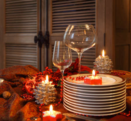 Christmas table preparations. Plates and empty glasses on the Chistmas table photo