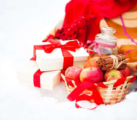 Christmas still life with a Christmas decorations, cookies and presents nestling in fresh snow Stock Photo - 23045876