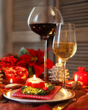 Christmas still life with white and red wine and Christmas decorations photo