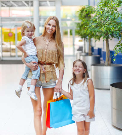 Happy smiling family on shopping in the store photo