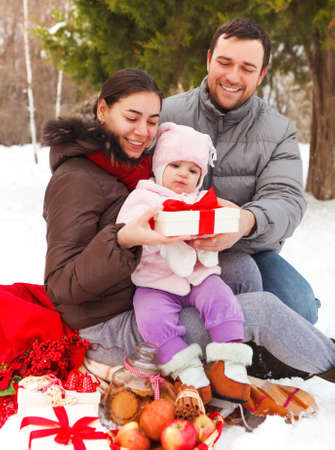 Happy smiling family with at the winter picnic outdoors Stock Photo - 23098787