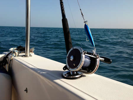 game fishing: Big game fishing reels and rods in the ocean Stock Photo