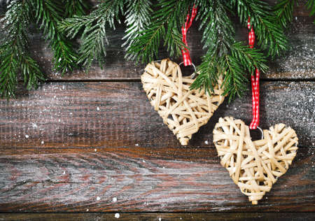 Christmas fir tree with Christmas decorations on the wooden board  photo