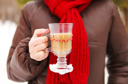 unrecognisable person: Woman holding cups of hot chocolate outdoors. Winter and warm concept Stock Photo