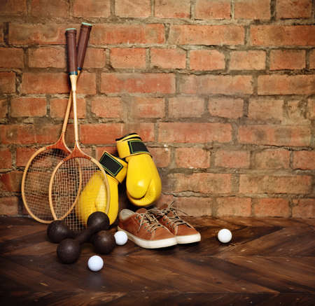 Sports equipment near the brick wall.Retro style photo