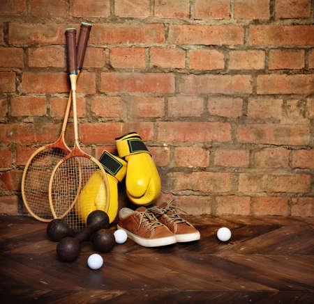 quiting: Sports equipment near the brick wall.Retro style Stock Photo
