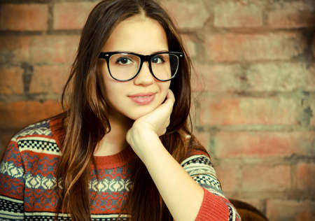 cute teen girl: Close up portrait of a beautiful cute teen girl wearing glasses in the living room