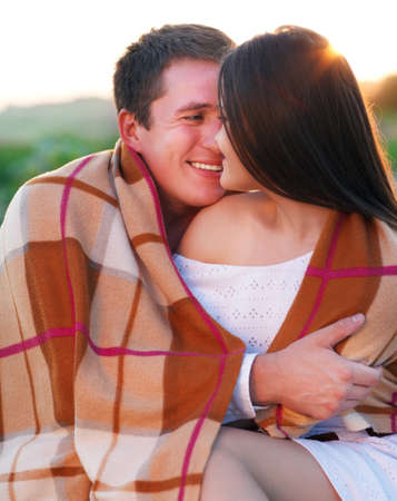 Young happy couple in love in summer day. Outdoors portrait photo