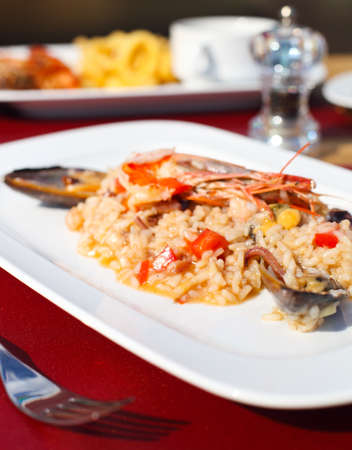 Classic risotto with the seafood in white bowl photo