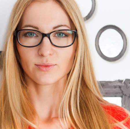 wearing glasses: Portrait of the woman wearing black eye glasses Stock Photo