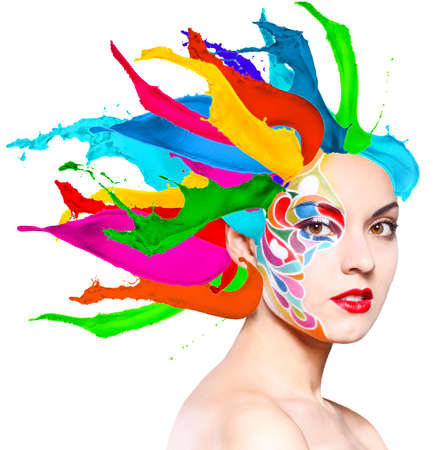 black hair blue eyes: Portrait of a beautiful young model with bright make up and colored splashes isolated on white Stock Photo
