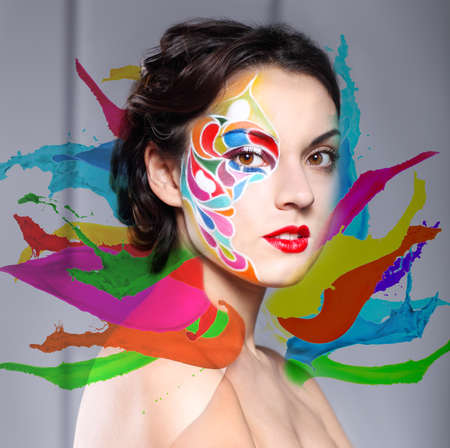 Portrait of a beautiful young model with bright make up and colored splashes photo