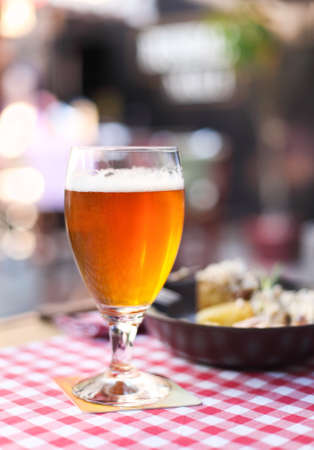 calamares: One glass of light beer with salad in the pub Stock Photo