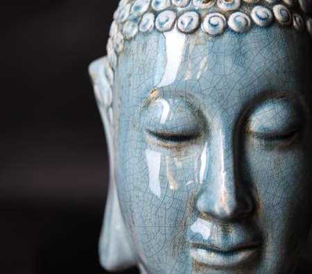 faience: Buddha close up portrait over black baground