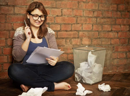 creative writer: Young woman writer working in the loft Stock Photo