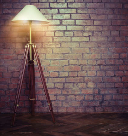 Interior of loft with retro lamp over brick wall photo
