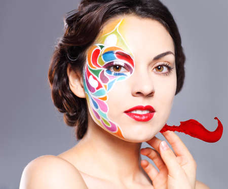 Portrait of a beautiful young model with bright make up and colored splash photo