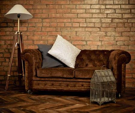 Interior of loft with velvet sofa and lamp Stockfoto