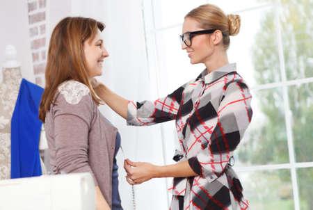 workshop service: Designer working with client in fashion atelier