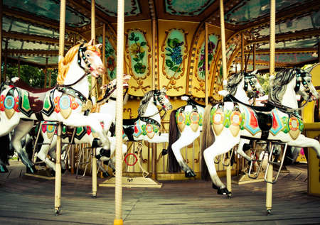 Carousel. Horses on a carnival Merry Go Round Stock Photo