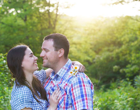 Young happy couple in love in spring day. Outdoors portrait photo